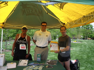 "Handing out flyers and information about the Brain Injury Association's ""Miracle Mile"" events at the GMU Fairfax campus"