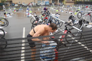 Looking for his triathlon race number and singlet, Doug Landau loses precious time in transition