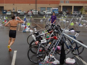With his bike number on his shorts, a quick gulp and out Doug Landau goes to run down the competition at the Reston Triathlon
