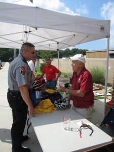 Even Fairfax County Police submit their bike helmets for safety inspection by race volunteers before the Annual Reston Triathlon