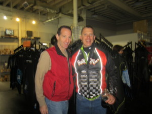 Triathlete and coach Brian Clark and Triathlon Trial Lawyer Doug Landau of the Herndon law firm ABRAMS LANDAU, Ltd., trade training tips at the RATS Annual Ironman party