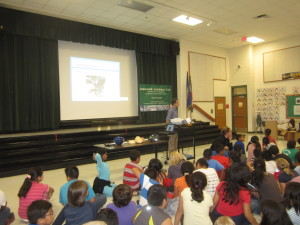 Before giving a new free Bell helmet to each 5th grader at Rolling Ridge Elementary School in Sterling Virginia, Doug Landau teaches the students about brain injury and bike safety