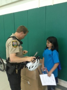 Local Police help with helmet distribution at Guilford Elementary School