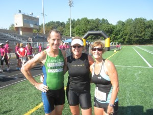 Herndon bike injury lawyer Doug Landau, popular spin bike instructor Denise Morgan & Melissa Landau are all smiles after the 30th Annual Reston Triathlon at Sough Lakes High School