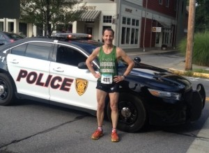 "After copping yet another age group award and top 20 overall finish, Litchfield County CT injury lawyer Doug Landau poses on the main street of Rhinebeck New York after the annual ""Mad Dash"" 5km. road race"