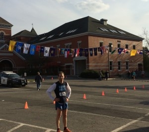 Doug Landau with the 50 state flags before the start of the Diane Burr Memorial road race in Thomaston, Connecticut