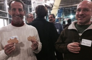 Herndon bike lawyer Doug Landau enjoys the cycle cookies as Lifetime Fitness indoor triathlon champion Eric Mackem of Reston samples some of the local brewery's offerings.