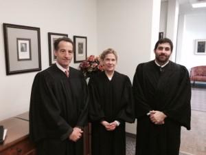 Landau, left, donned a judge's robe to participate in the William B. Spong Invitational Moot Court Tournament in Williamsburg, VA.