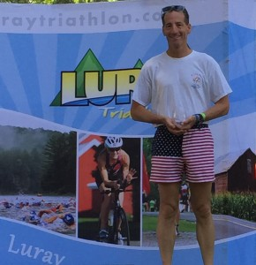 Doug Landau on the podium at the USAT Mid-Atlantic Regional Championships in Luray, Virginia