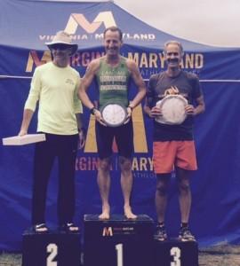 Age Group winners received acorn clocks. Bill Coquelin, Doug Landau & Ben Foy enjoy their awards on the podium