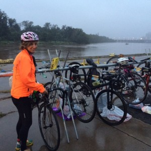 Melissa Landau racks her bike for the Rockettes Landing Olympic Distance DUathlon, with the mighty James River and downtown Richmond in the background