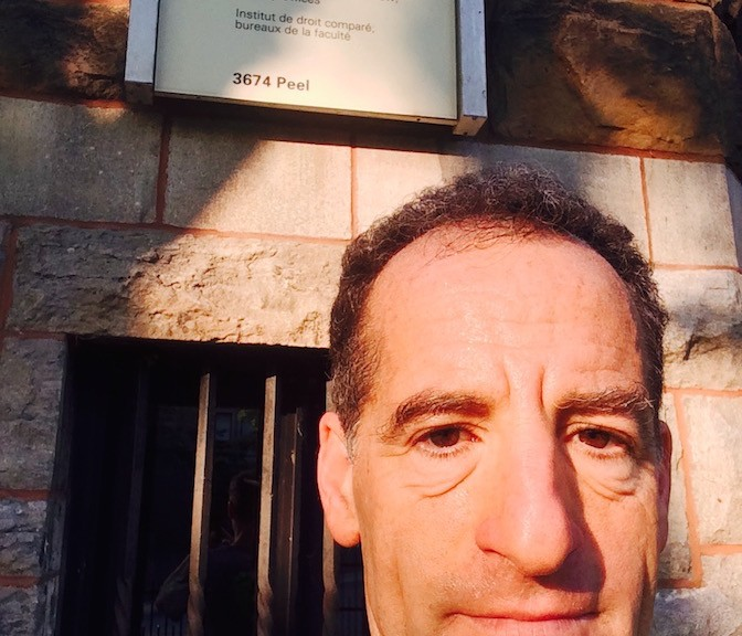 """""""Sometimes insurance policy language seems to be written in a foreign language,"""" notes Prince William County accident lawyer Doug Landau, shown in front of McGill University Law School during the morning run before his injury law speech at the American Association for Justice annual convention"""