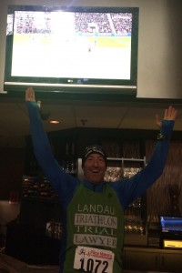 At a bar before 9 AM on Super Bowl Sunday ! Doug Landau enjoys a British Premier League game during the PreGame 5km awards ceremony at the National Conference Center in Leesburg, Virginia