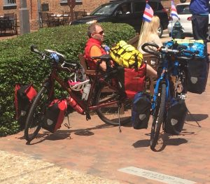 """Bikers from all over the world, like these bicycle tourists visiting Colonial Williamsburg, need to know the """"rules of the road"""" in order to avoid injury."""
