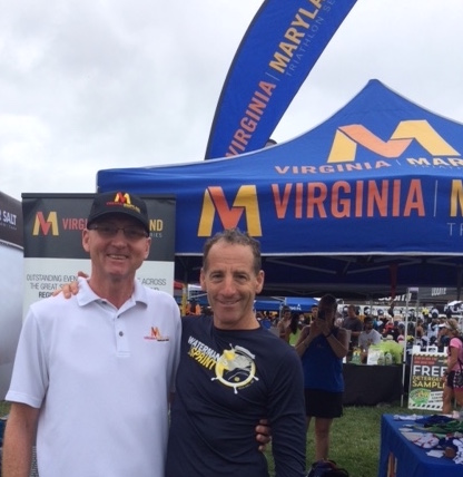 Top Virginia & Maryland Super Series racer (AND race organizer) Don White & Series sponsor Doug Landau, pose in front of the VTS/MTS tent at the USAT National Championships pre- race expo in Omaha, Nebraska.