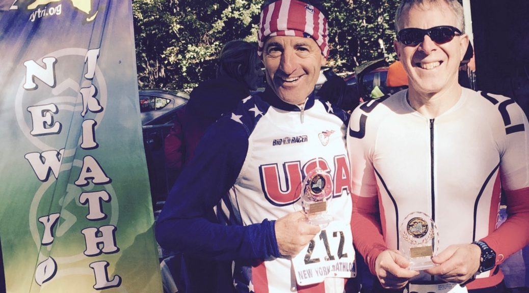 Age group prize winners Paul Greenberg & Doug Landau are all smiles as the sun came out at the end of the 32nd annual Central Park DUathlon in the heart of New York City