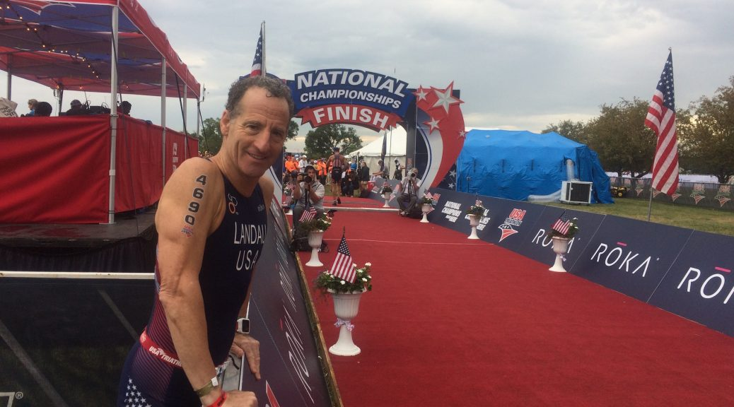 Herndon injury lawyer Doug Landau under stormy skies in Omaha, Nebraska, after finishing the 2017 USA Sprint Triathlon National Championship