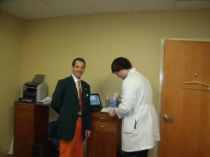 Doug Landau attending a client's recent medical exam in a contested spinal injury workers compensation case, where his clieint's back surgeon has indicated a lumbar spine operation is needed and the insurance company has denied authorization for the operative procedure