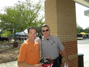 Reston Triathlon volunteer Doug Landau checking helmet safety before tomorrow's annual race at South Lakes High School