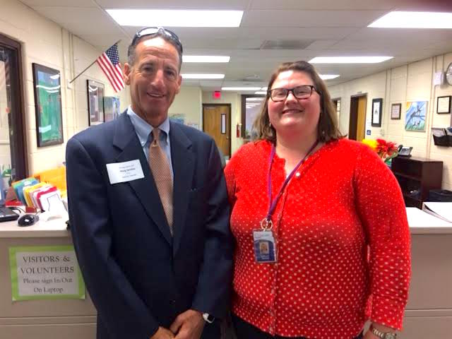 Landau is shown at the Langston Hughes Middle School principal's office with teacher Lesley Boger, who was coordinating the 8th grade civics classes for this Reston public school.