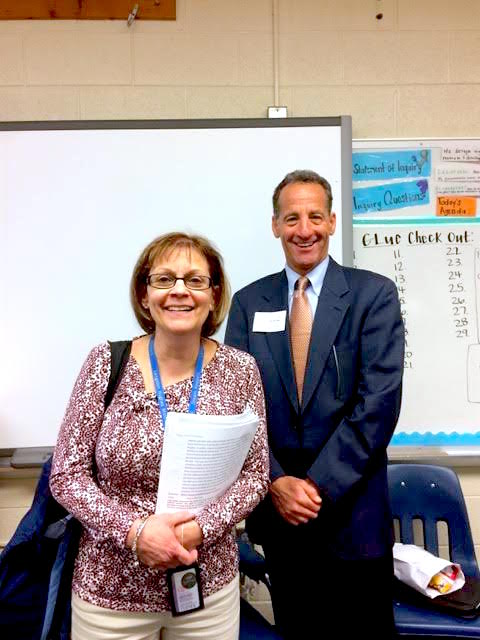 Fairfax Bar Association volunteer Civics teacher Doug Landau and 8th grade teacher Ms. Negri shown after class. The Langston Hughes Middle Schoolers learned about legal procedures, criminal justice and the courts from experienced Fairfax County lawyers and judges.