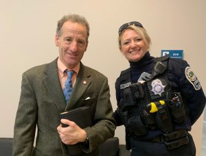 Attorney Doug Landau with a Herndon police officer