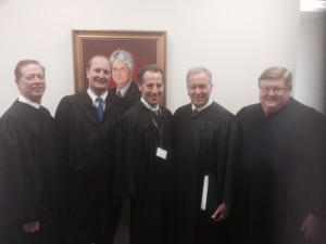 Landau, center, shown here with other panel judges at the William B. Spong Moot Court Invitational Tournament on February 13 -14, 2015.