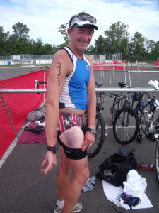 Despite road rash, cuts and other injuries, Traithlete John Brannock finished the Warrenton Sprint Triathlon with a smile
