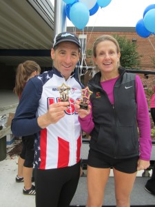 "Top age group road racer Sarah Buckheit and Doug Landau were winners at the ""Blue Jay 5km and Heroes"" races in Manassas Virginia"