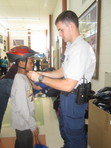 Police helped fit new helmets on Herndon Virginia sixth graders at two local Fairfax County Elementary Schools
