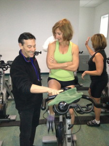 Melissa gets instruction on the GO GREEN FITNESS environmentally friendly indoor spin exercise bike