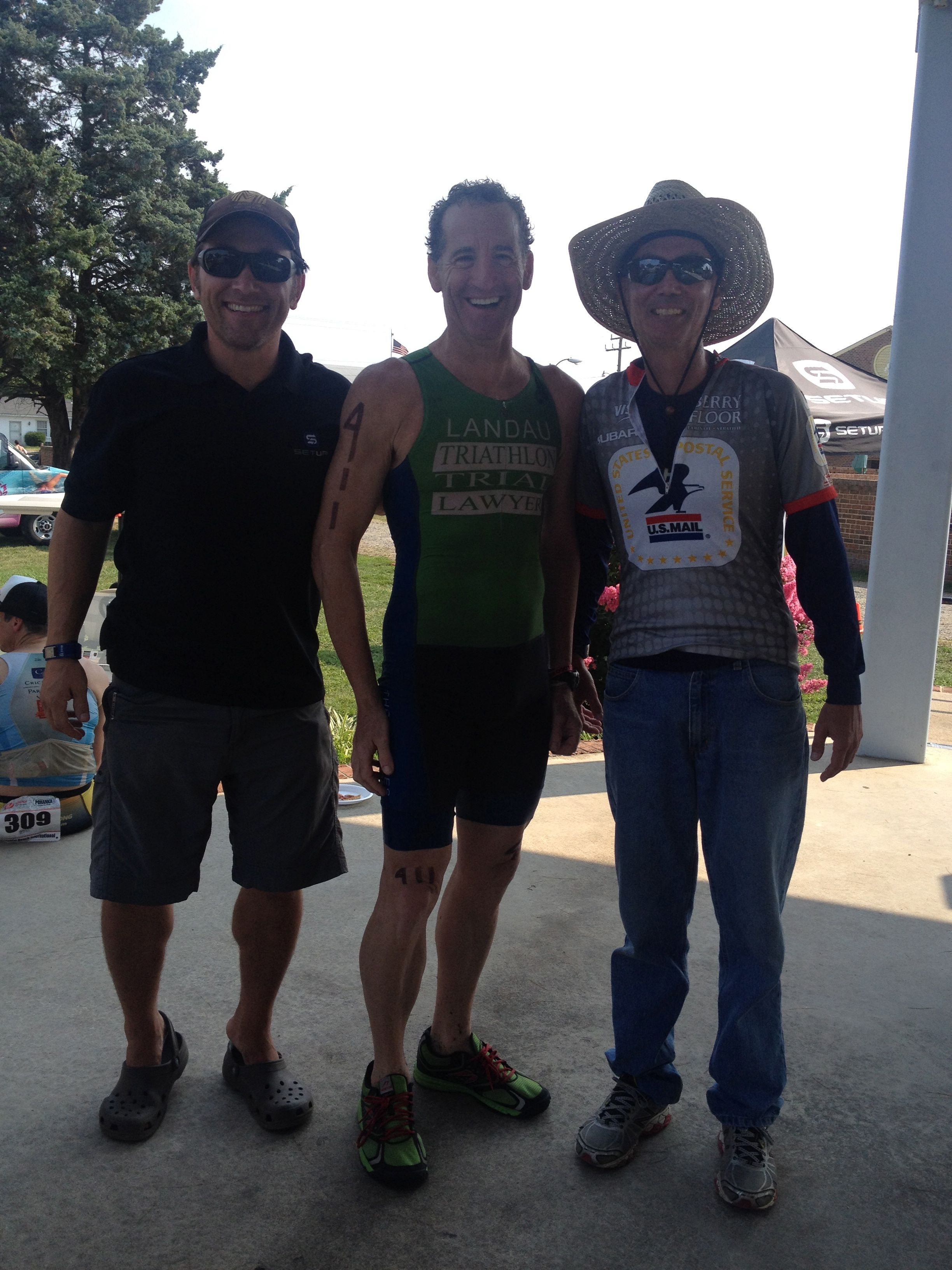 SetUp Inc.'s Greg Hawkins, VTS Sponsor Doug Landau & Terry McLaughlin of the YMCA after the 2014 Colonial Beach Triathlons