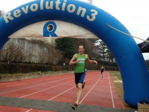 After racing around the track barefoot & stripping off his dry wetsuit, Doug Landau won his heat at the DC Multisport Expo's Transition Race at American University