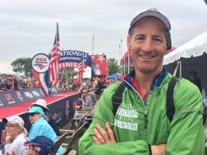 Doug Landau checks out the Olympic Distance race finish from the VIP tent. With a Jumbotron and drones, spectators could see their friends and teammates complete the National Championship course.