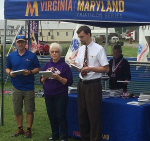 Race Director Greg Hawkins, the Mayor AND Vice Mayor of Rock Hall, MD and top triathlete medal-wearing Gail Waldman all help out at the awards ceremony !