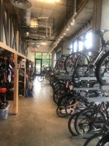 Interior of the Phoenix Bikes bike shop, showing lineup of many completed or in-progress bikes
