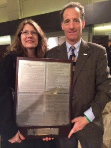 """Cynthia Burgett, Rachel Carson Middle School teacher, and Doug Landau, Herndon Virginia trial lawyer, holding the plaque for the """"We the People"""" national championship competition. The Northern Virginia middle school improved upon last year's third-place finish &and won the competition."""
