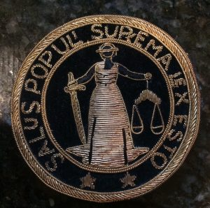 """The health of the people shall be the supreme law."" This Latin phrase, from Norman Landau's International Academy of Trial Lawyers seal, underscores the important of safety of the people in the eyes of the law."