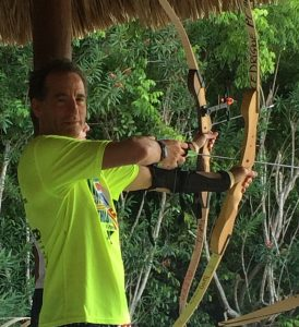 """The best lawyers, like the best archers, keep their eye on the target, and track deadlines and """"ammunition"""" very carefully. Here Herndon Social Security Disability lawyer Doug Landau takes aim during an archery tournament."""