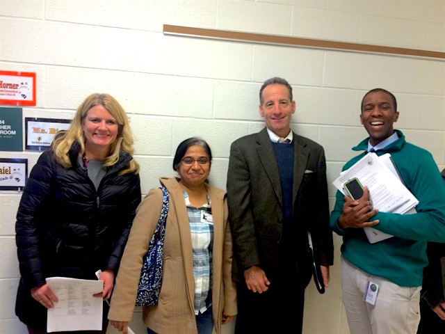 """R-L, Principal Gordon Stokes with Herndon lawyer Doug Landau and parent volunteers after coaching a """"We the People"""" class at Rachel Carson Middle School"""