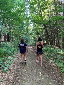 two women walking in the woods
