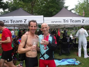 """Frazz"" comic strip creator Jef Mallet and Doug Landau clink their crystal award glasses after the Luray Triathlon"