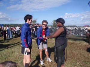 "Rehab 2 Racing Coaches and Award-Winning Triathletes Stephanie Colburn and Mary Delaney volunteered to do ""body marking"" at the Giant Acorn Triathlon in Spotsylvania, Virginia"