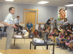 Herndon Virginia bicycle safety lawyer Doug Landau teaches Herndon sixth graders about preventing brain injury before giving each one their own new Bell bike helmet