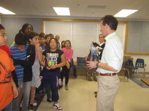 Virginia bike safety lawyer Doug Landau interacts with Herndon elementary school students who are about to be given free Bell bicycle helmets