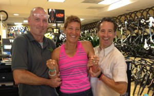"Bike Mechanic Extraordinaire Bernard Kocis and lawyer Landau give worlds qualifier Gail Waldman a ""lift"" before departure for the USAT DUathlon National Championships in St. Paul"