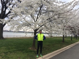Despite the cold, Doug Landau admires the blossoms at Hains Point in Washington, DC, after finishing 6th in the annual Race for Equal Justice 5km put on by GWU Law Students