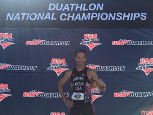 After finishing the USAT DUathlon National Championships, Doug Landau shows the medal he earned in Bend, Oregon Saturday