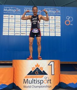 "While breathing ""like a wounded water buffalo during the race, Doug Landau was recovered enough a half hour later to strike a pose on the podium after the DUathlon Sprint World Championship race in British Columbia"